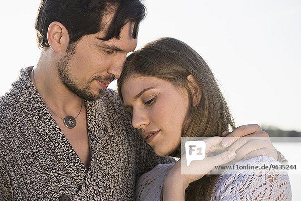 Close up portrait young couple embracing romantic