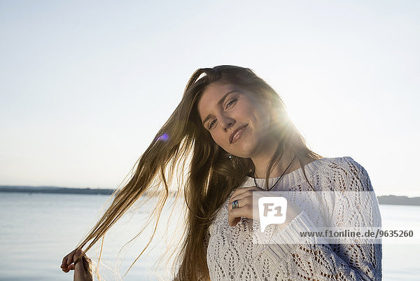 Happy portrait pretty young woman sunset