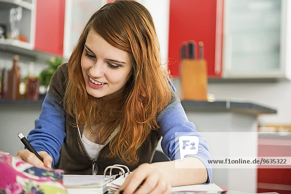 Young woman studying at home