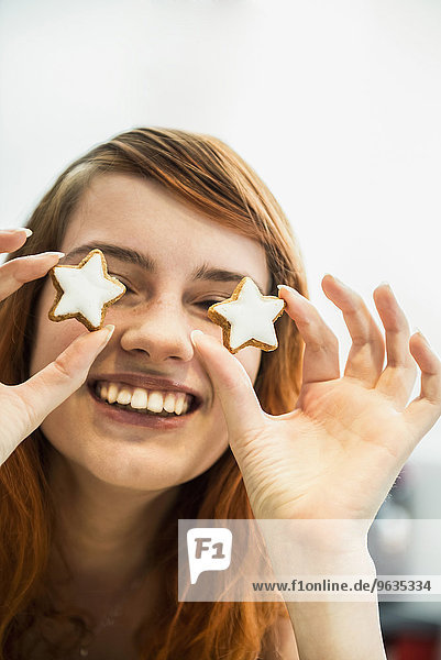 Close up of a red-haired young woman with cinnamon stars as eyes