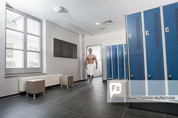 Man fitness studio changing rooms locker towel