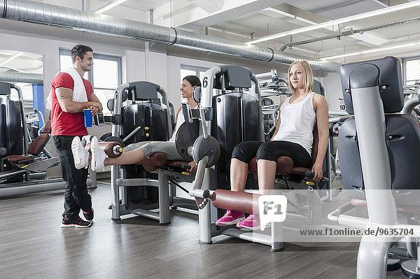 Three people fitness studio man two women sport
