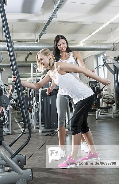 Women two fitness studio trainer sport practising
