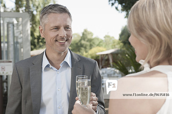 Couple party date attractive champagne toasting