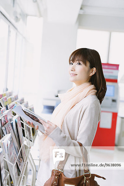 Young Japanese woman in a convenience store