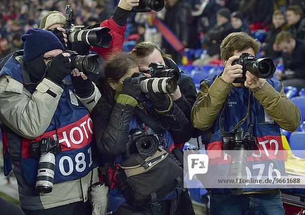 Press photographers at a Champions League football match  Basel  Switzerland  Europe
