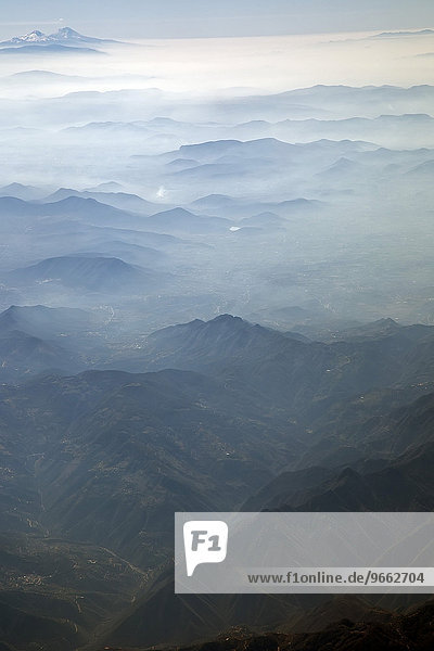 Mist on the mountains surrounding Mexico City  Mexico  North America