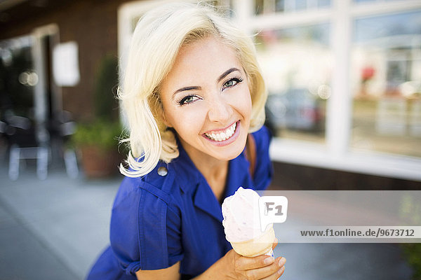 Portrait of smiling woman with ice-cream