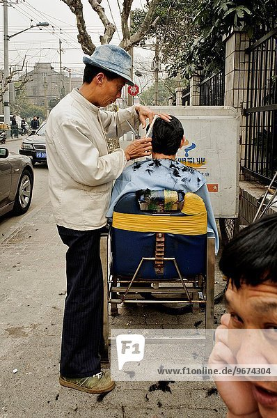 A barber in the street  Shanghai  China  Asia.