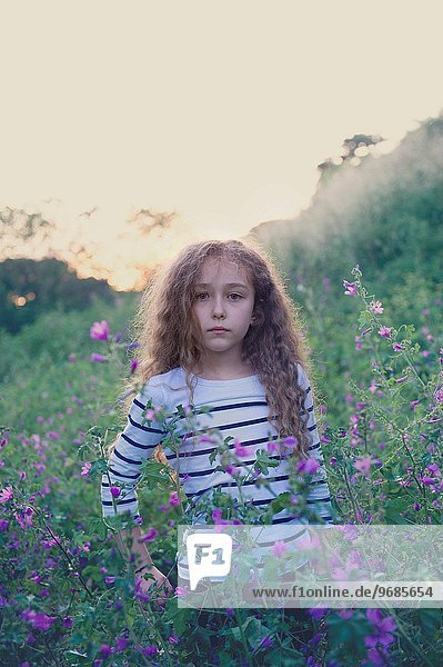 Italy  Portrait of girl (10-12) standing among purple flowers
