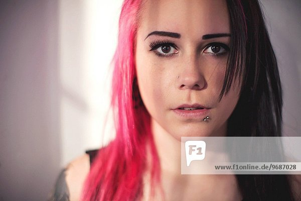 Portrait of young woman with dyed hair  Massachusetts  USA