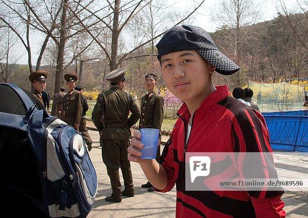 Teenager With Cap At Funfair  Pyongyang  North Korea