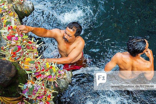 People and purifying pool. Tirtha Empul Temple. Bali. Indonesia  Asia.
