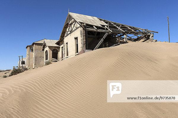 Old houses in the former diamond town  now a ghost town  Kolmanskop  Kolmannskuppe  near Lüderitz  Namibia  Africa