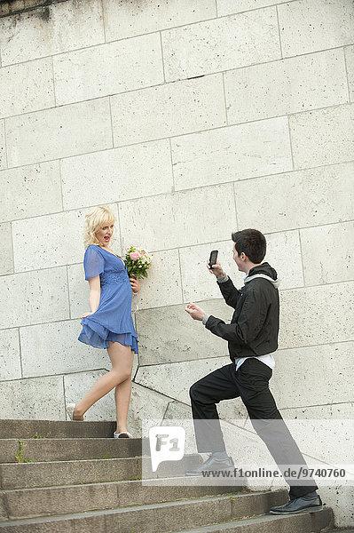 Europäer Mann Freundin fotografieren