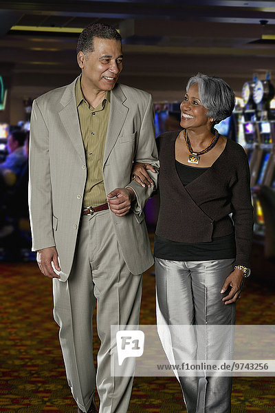 Excited Black couple walking in casino