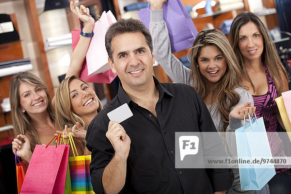 Hispanic friends shopping together