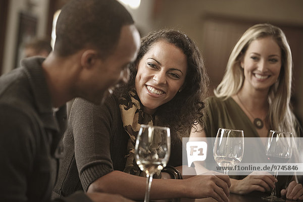 Friends drinking wine together