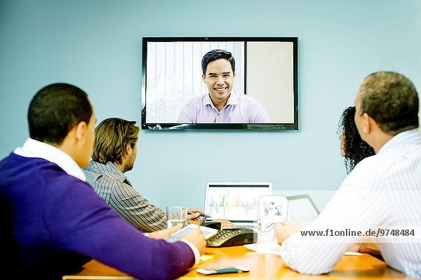 Business people having video conference in office meeting