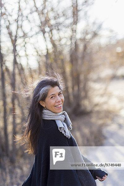 Older Hispanic woman walking outdoors