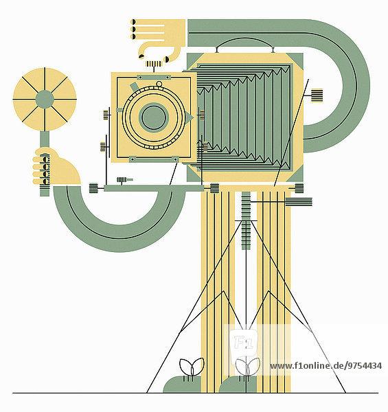 Mann fotografiert mit altmodischer Balgenkamera