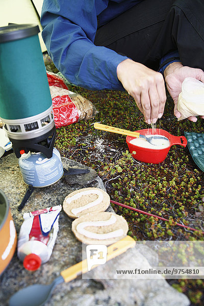 Hiker preparing food in tent
