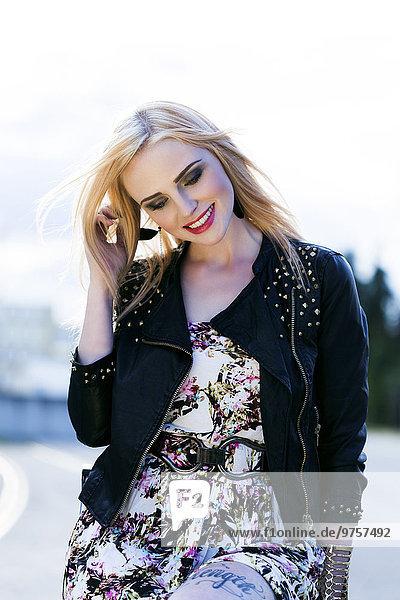 Portrait of fashionable smiling blond woman