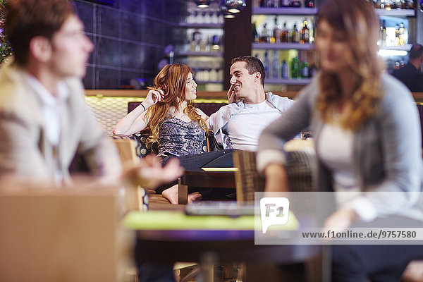 Couple socializing at hotel bar