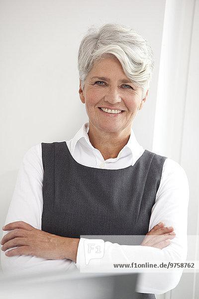 Porträt einer lächelnden reifen Geschäftsfrau