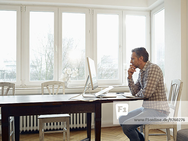 Germany  Cologne  Mature man working from home Germany, Cologne, Mature man working from home