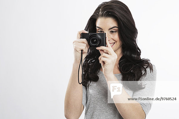 Portrait of young woman with camera