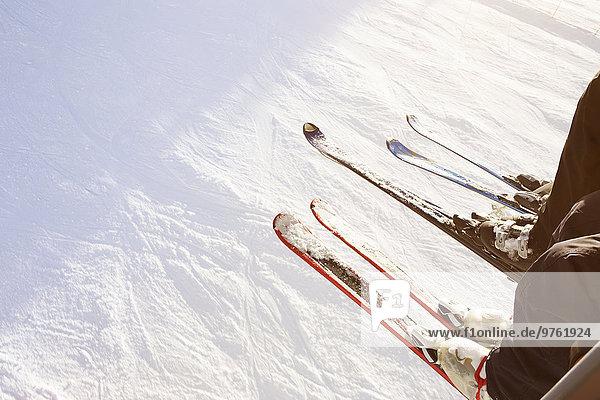 Österreich  Salzburger Land  Sessellift  Skifahrer