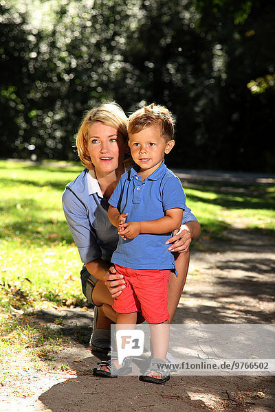 Mother with son in a park