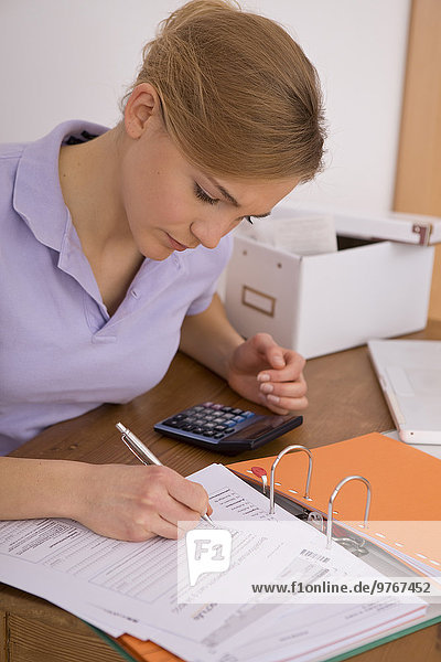 Woman working on tax return