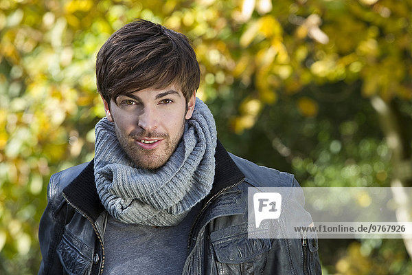 Brown-haired young man outdoors  portrait