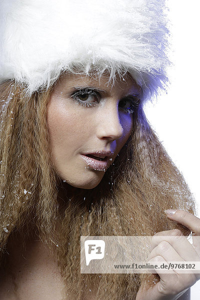 Attractive young woman wearing fur hat  portrait