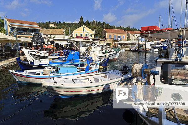 Harbourside with boats and cafes  Fiskardo  Kefalonia (Cephalonia)  Ionian Islands  Greek Islands  Greece  Europe