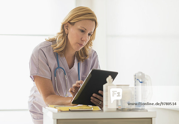 Female doctor using tablet pc