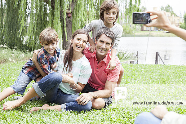 Using digital camera to photograph family  personal perspective