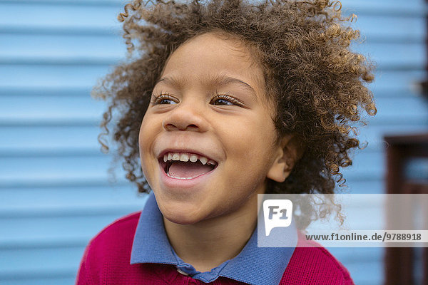 Pacific Islander boy laughing outdoors
