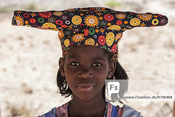 Local Herero girl  with typical headgear in Uis  Namibia  Africa