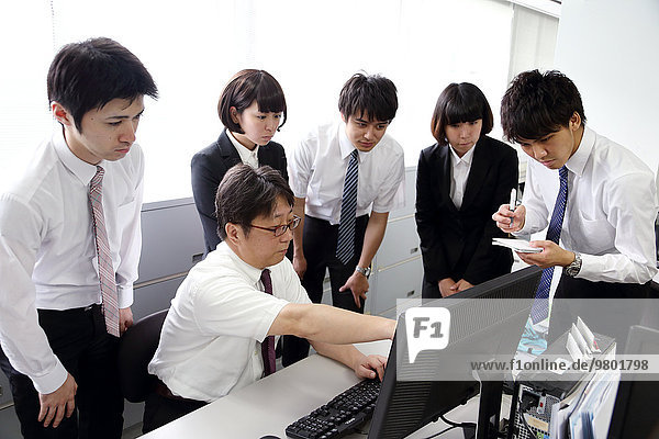 Japanese business people working in the office