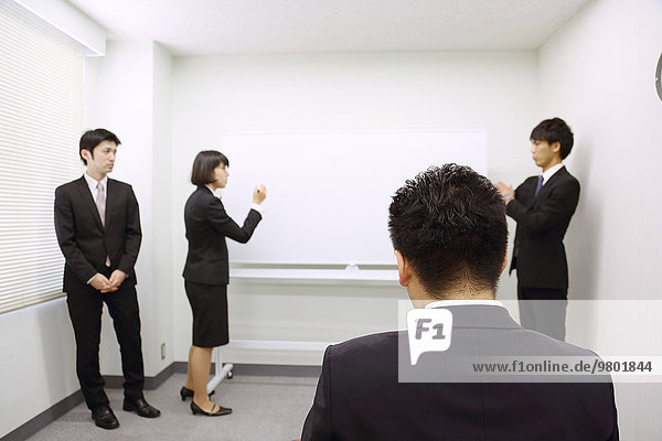 Young Japanese business people work examination