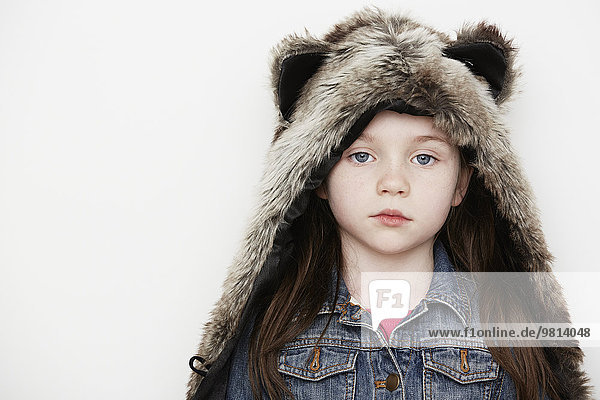 Girl wearing furry hat