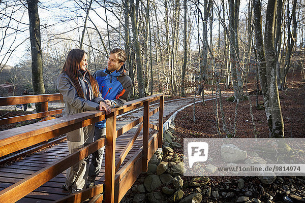 Hikers on bridge  Montseny  Barcelona  Catalonia  Spain