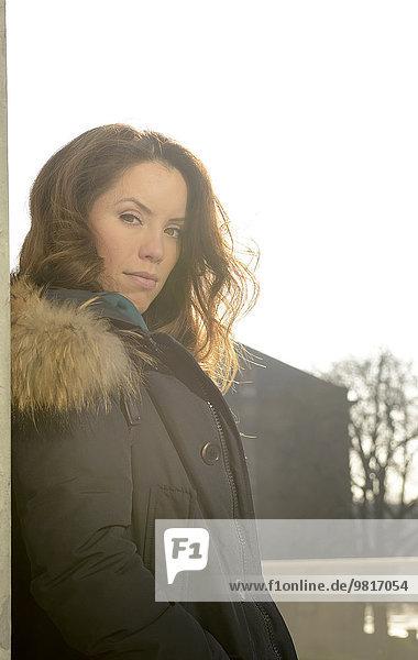 Portrait of brunette young woman in coat