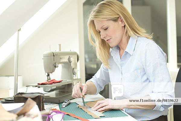 Woman at table tailoring