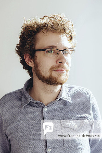 Portrait of bearded man with curly hair