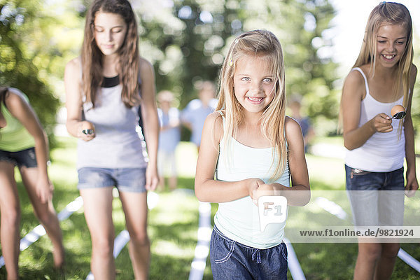 Girl competing in an egg-and-spoon race