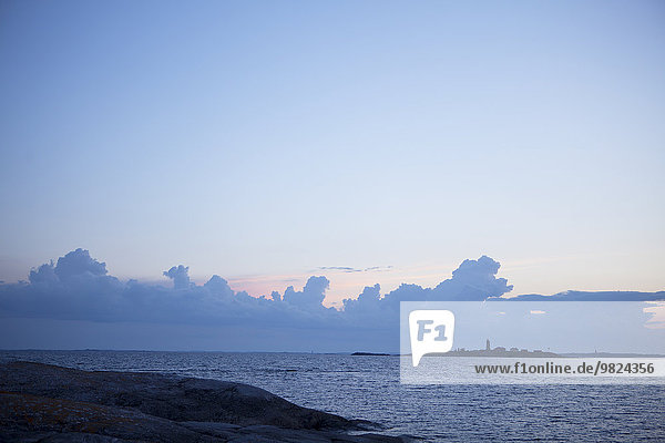 Sea with lighthouse on background